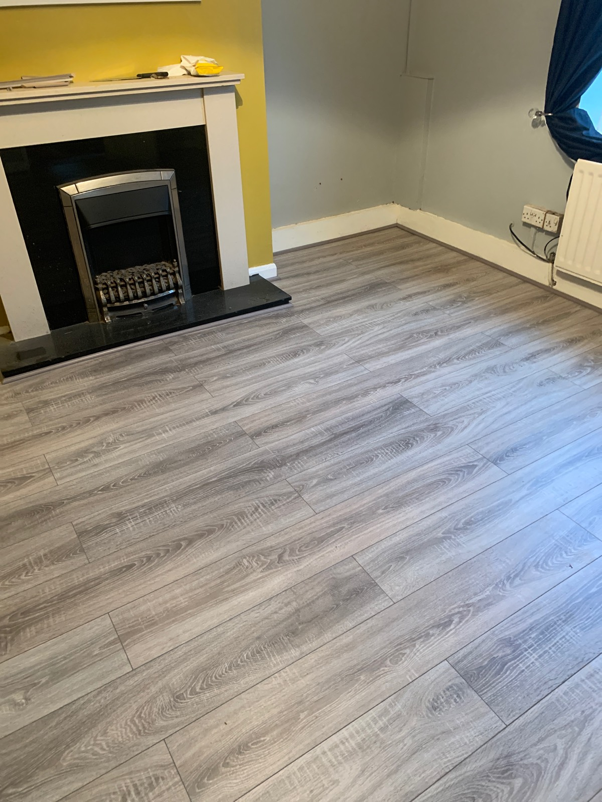 light laminate flooring in living room around fireplace