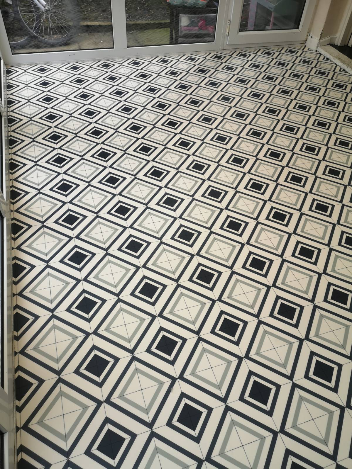 vinyl flooring with tile design in empty kitchen