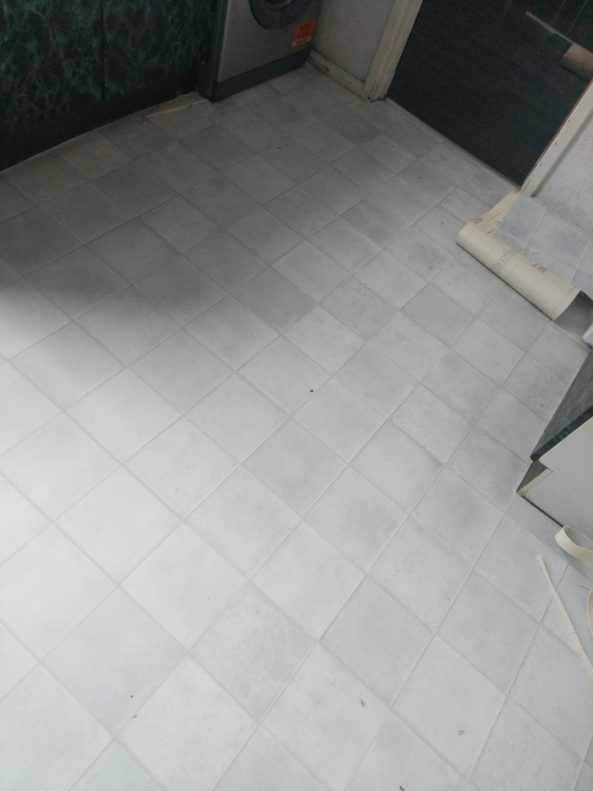 light vinyl flooring with tile design in kitchen