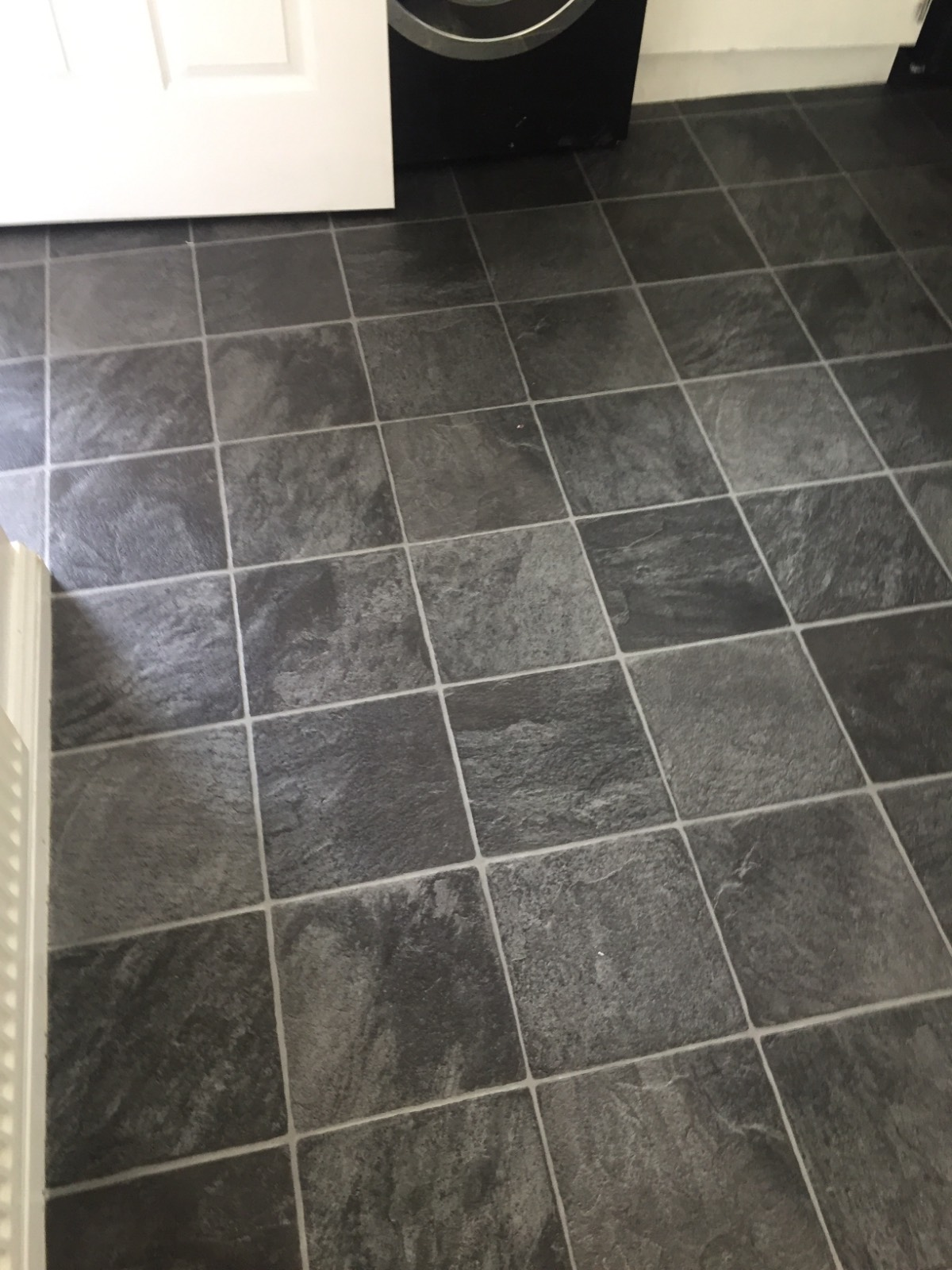 dark tile design vinyl flooring in kitchen