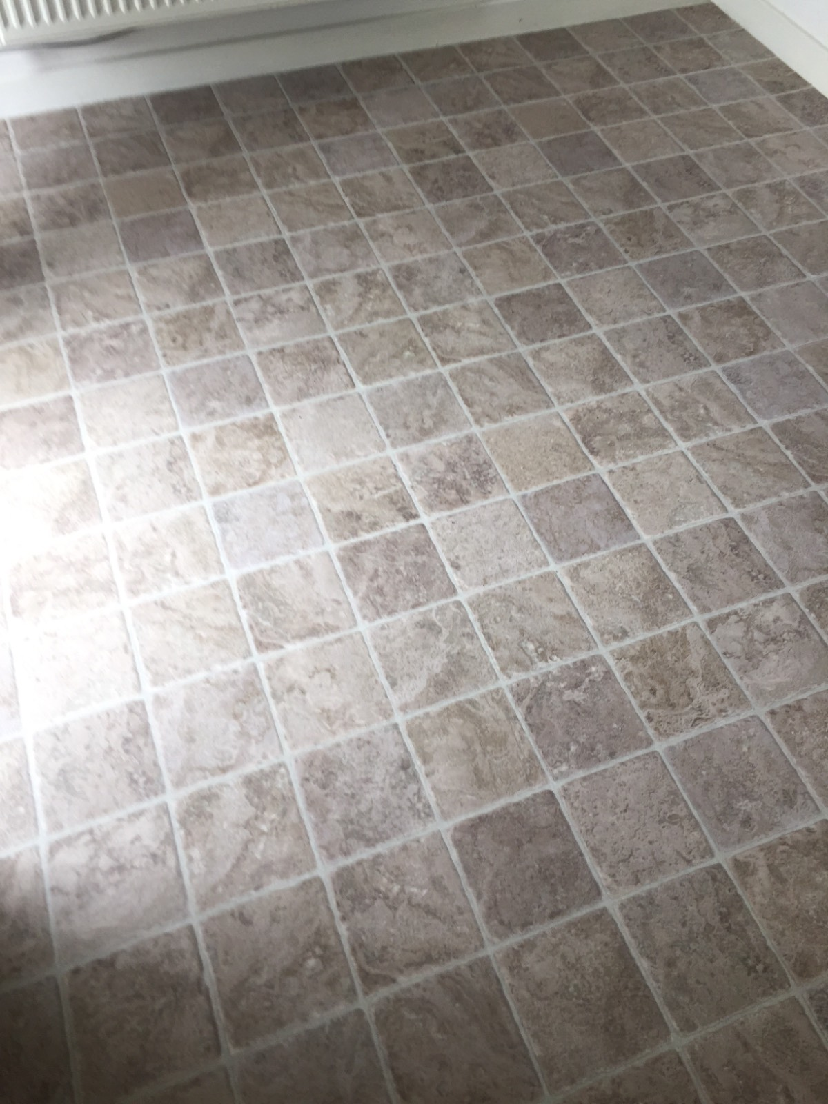 light brown vinyl flooring with tile design in kitchen
