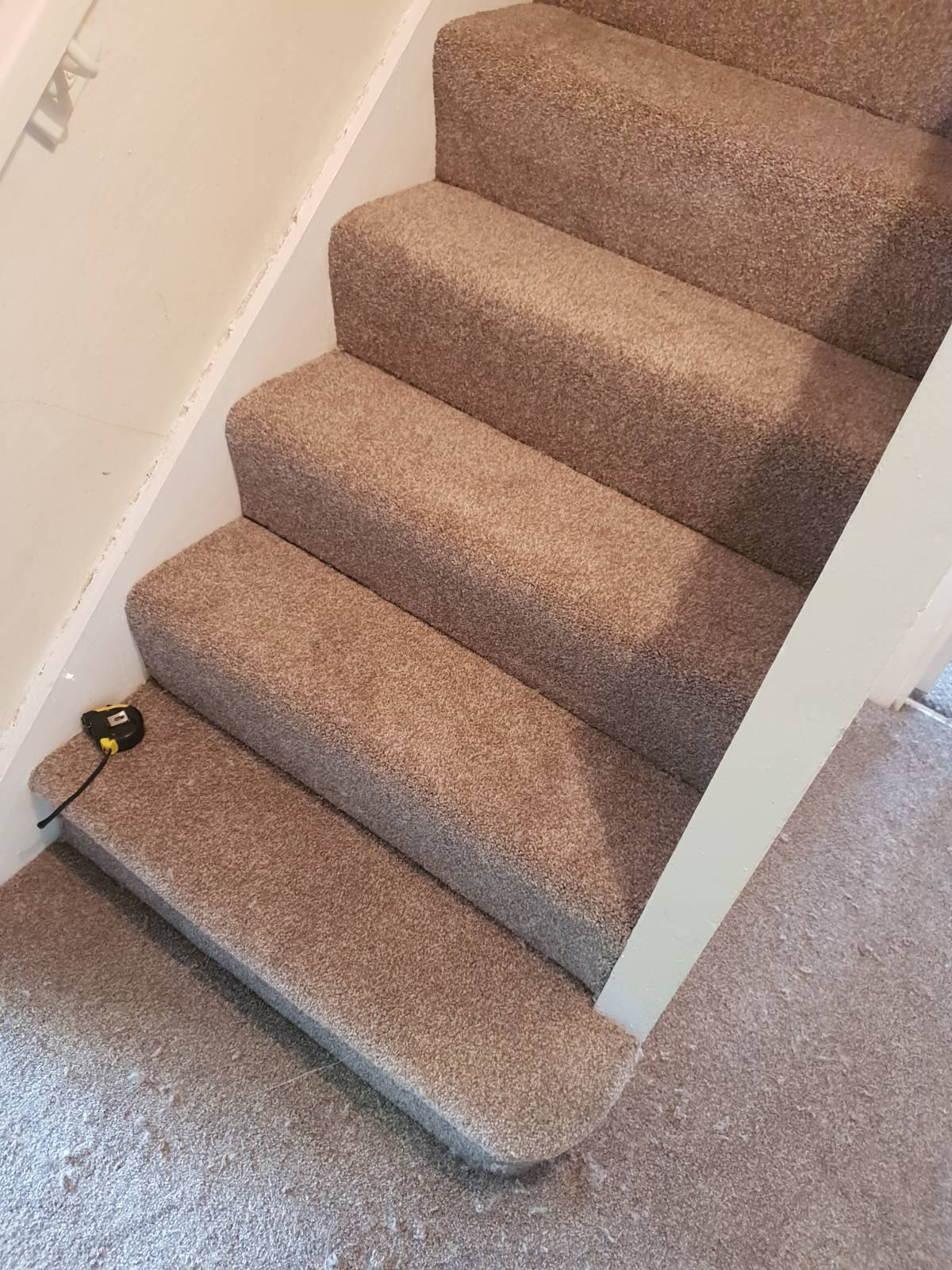 light carpet fitted on staircase and hallway