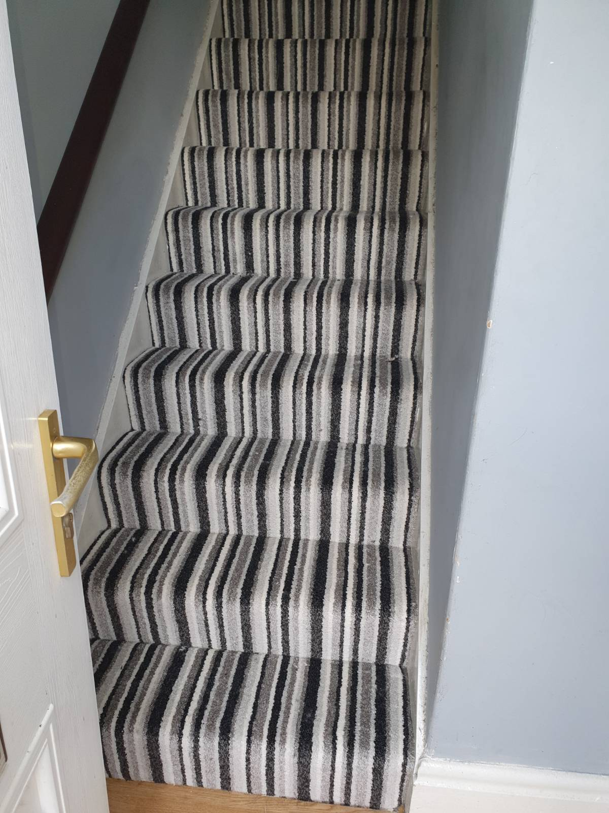 grand stripe carpet fitted on stair case