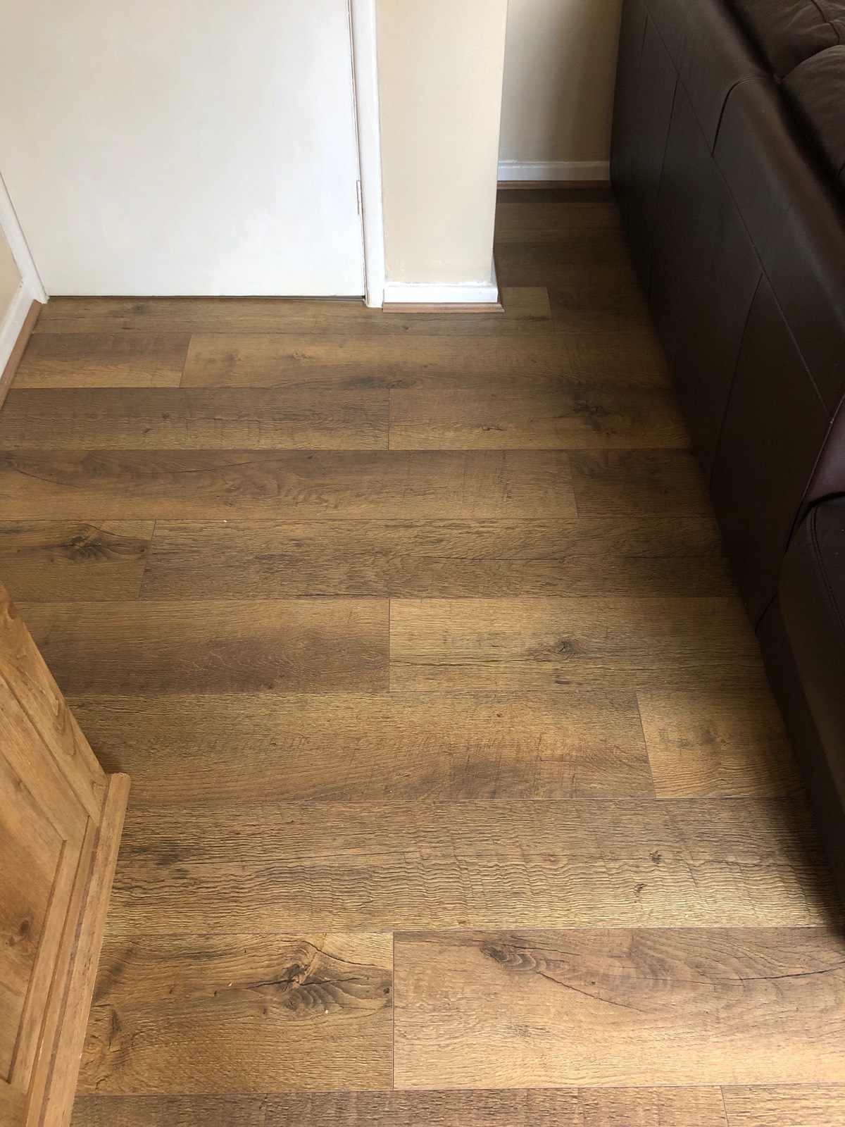 dark wooden laminate flooring fitted in living room