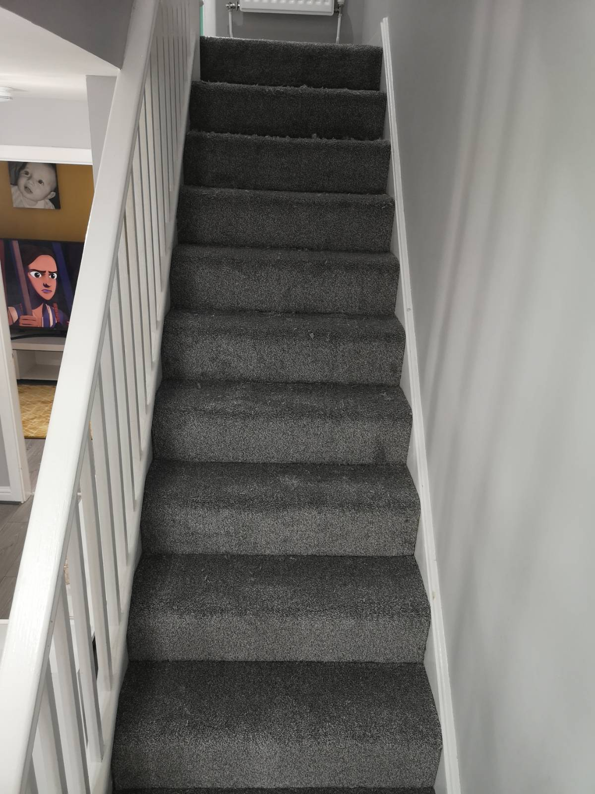 after image of grey carpet fitted on staircase