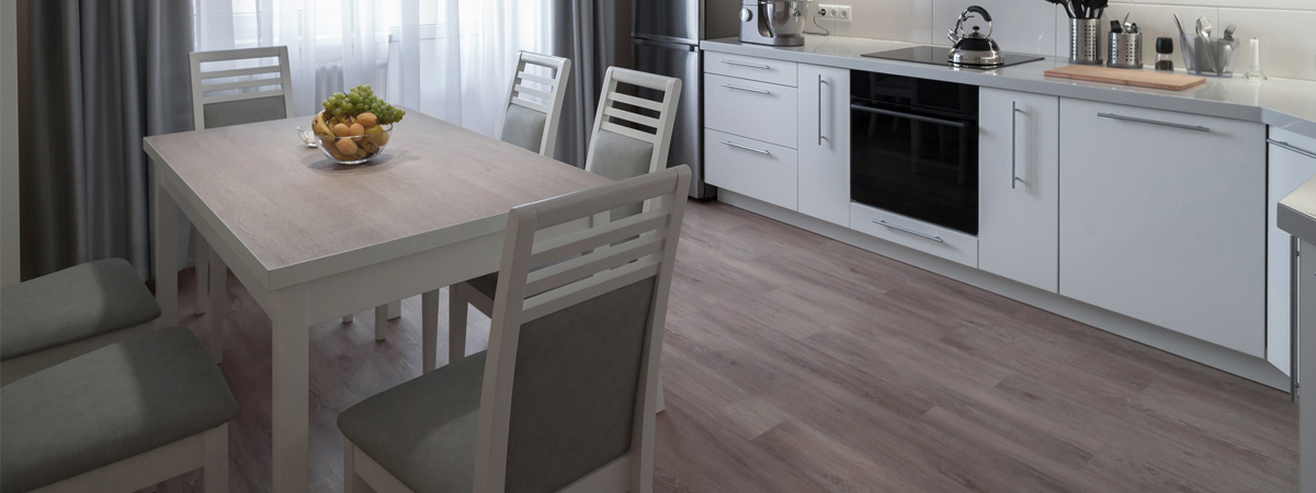 Image of kitchen, with dining table and laminate flooring