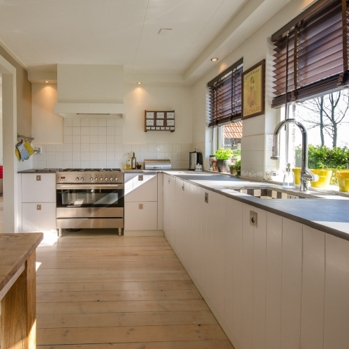 Image of laminate flooring in kitchen with sunset lighting