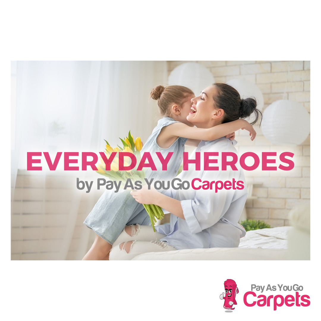 happy little girl giving flowers to mother with Everyday Heroes strapline